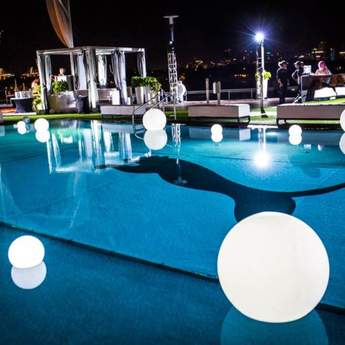 Brand activation lighting pool glowing spheres Miami