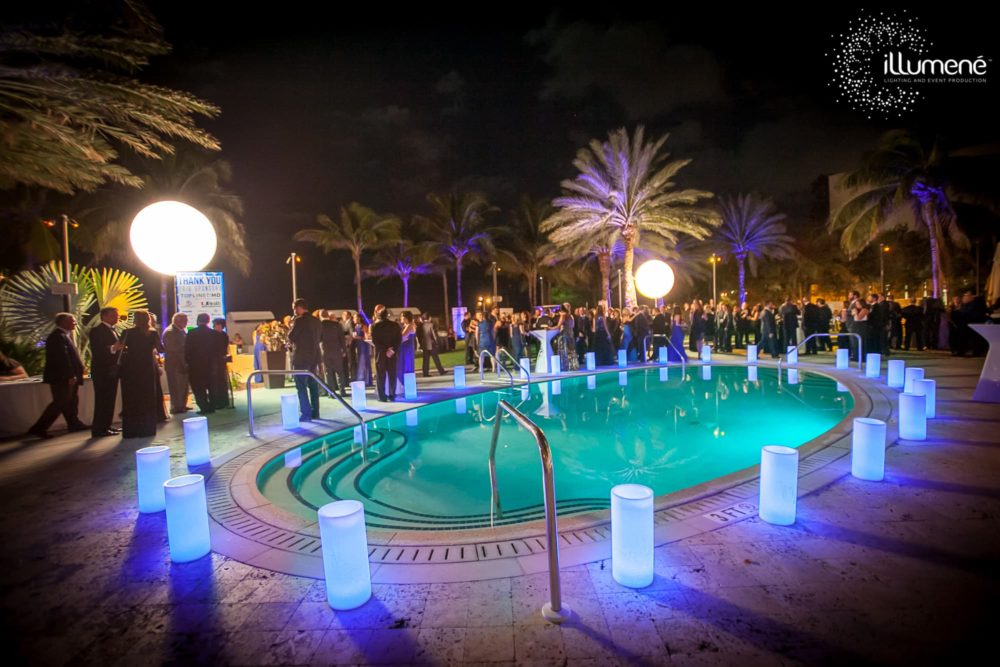 Airstars and large wax luminaries for a corporate event Miami