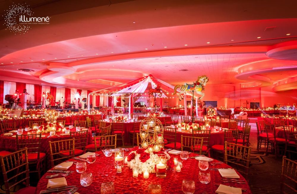 Fontainebleau circus corporate party red uplighting