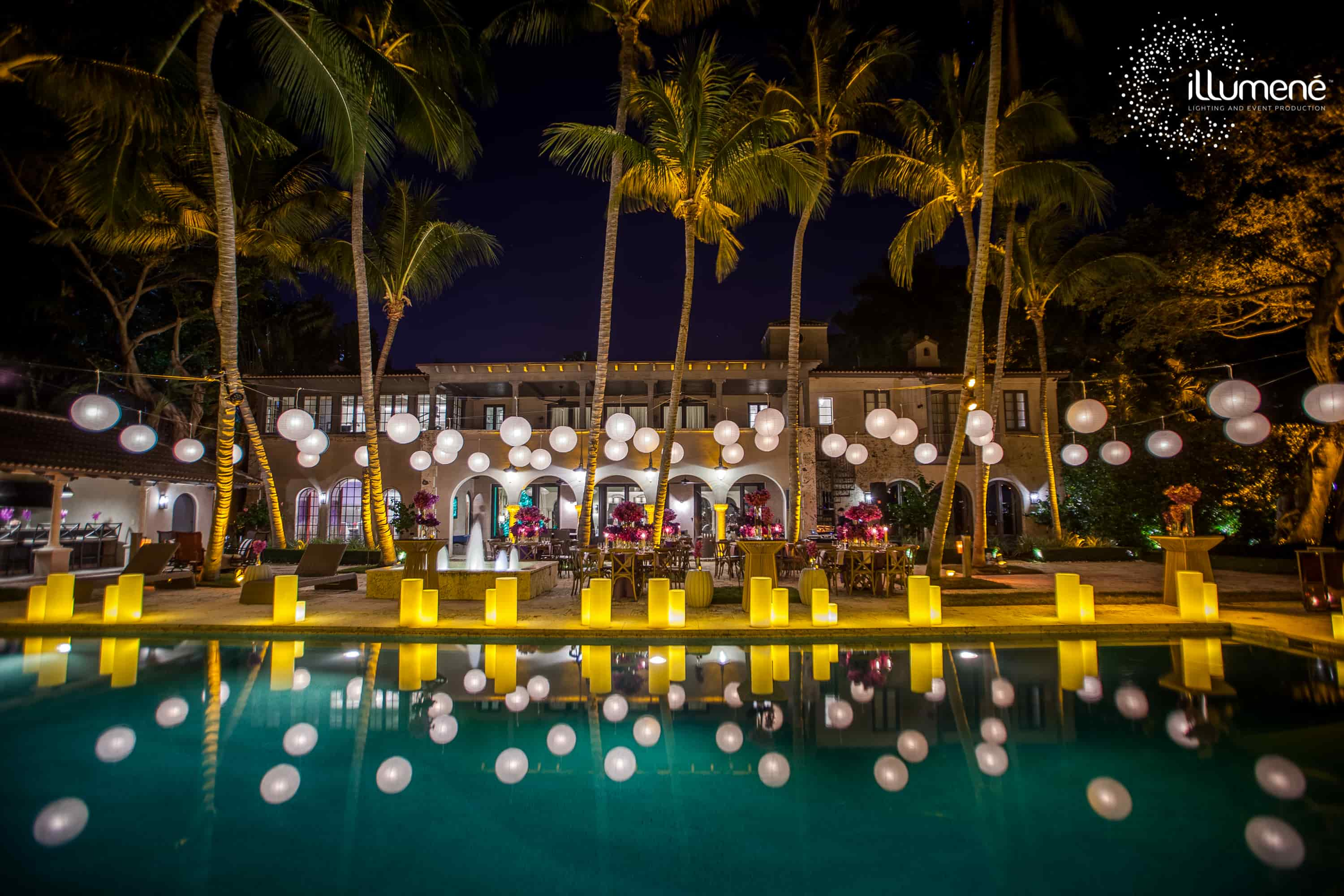 paper lanterns and large candles by the pool Miami